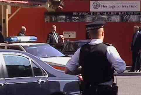 Henry Kissinger gets into his waiting car outside the Royal Albert Hall