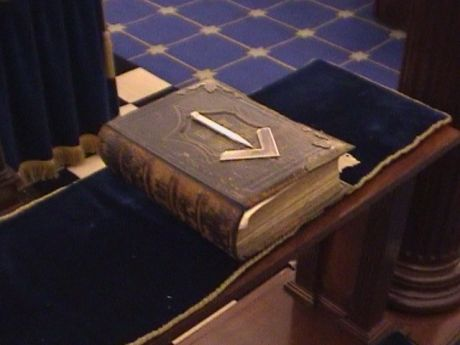 Holy Bible topped with square and compasses in craft masonry (1st to 3rd degree) lodge room at Bristol Freemasons Hall, Park Street