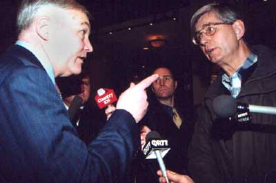 Conrad Black wags a finger at Calgary Herald striker Andy